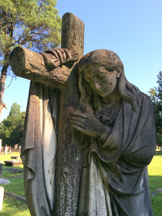 This angel leaning on a cross stands over the grave of Ann Kinchley Austin.