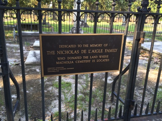 This sign hangs on the wrought iron fence surrounding the De L'Aigle family plot. They donated the land for Magnolia Cemetery.
