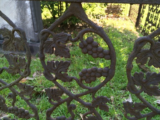 The leaf and grape design on this wrought iron fence is still intact.