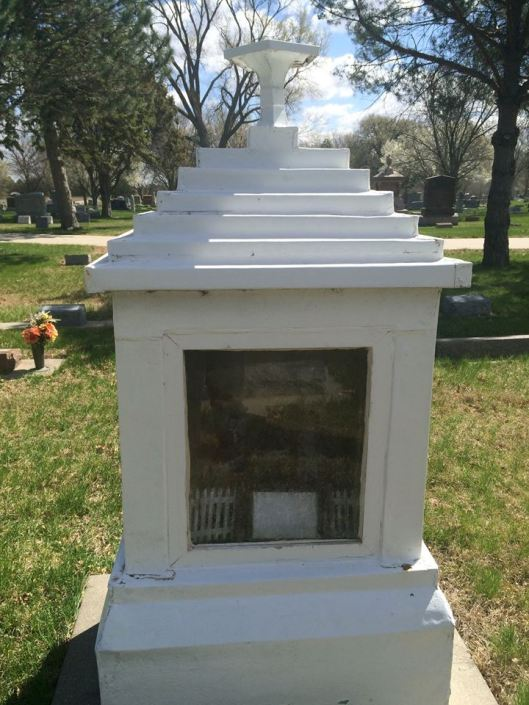 According to Greenwood sexton Todd Gardner, the marker is maintained by a man who comes every year or so to visit the site and touch up the white paint that covers the tin.