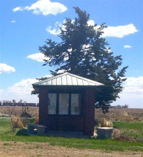 A small shelter with a directory of names/grave locations is at the back of the cemetery.